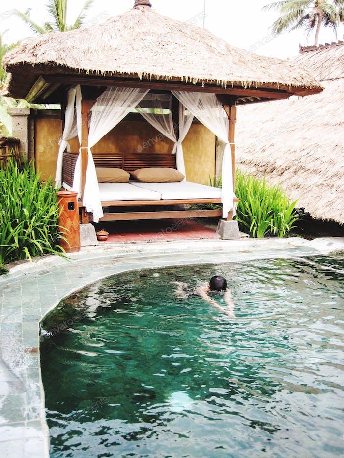 Swimming in a villa backyard