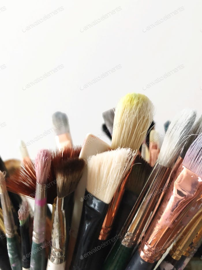 Close up artist painting brushes paint bristles detail.