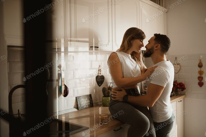 happy couple sitting in the kitchen