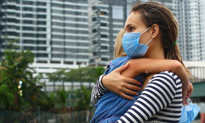 Woman hugs daughter, coronavirus epidemic