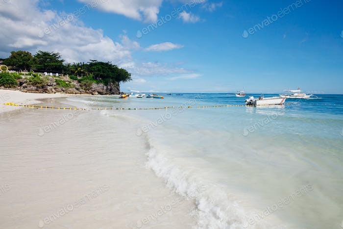 The popular white sand Alona Beach located on Panglao Island, Bohol, Philippines
