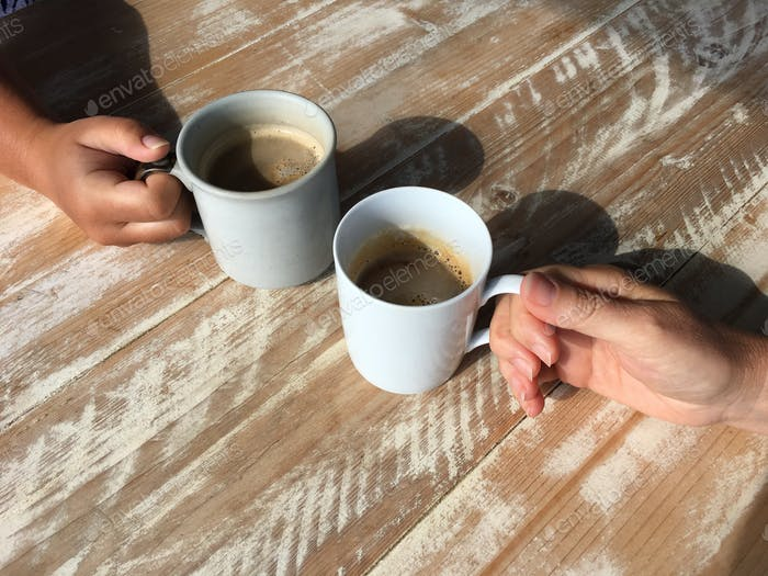 Coffee date, close up of hands on coffee mugs