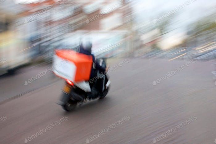 Delivery Motorcycle in motion motion blur