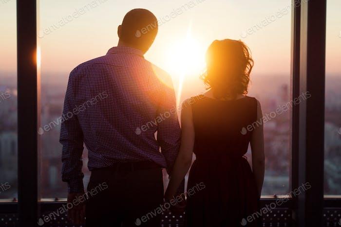 A couple. Sunset
