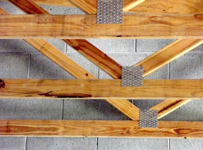 Roof trusses in a ceiling