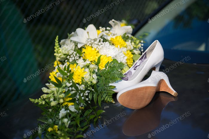 Wedding car decor and white shoes