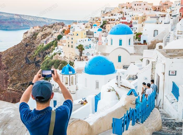 Tourist Taking Photo With Smartphone In Famous Greek Island Santorini