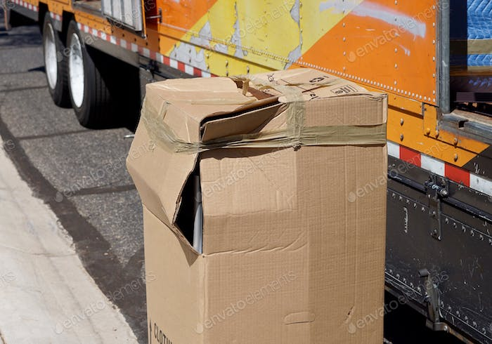Damaged box unloaded from a moving van cargo area