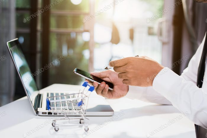 Online shopping concept, businessman shopping online is a form of electronic commerce