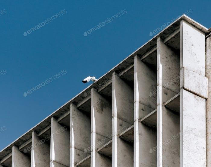 Minimalist architecture, concrete building, cctv camera, surveillance camera, building exterior.