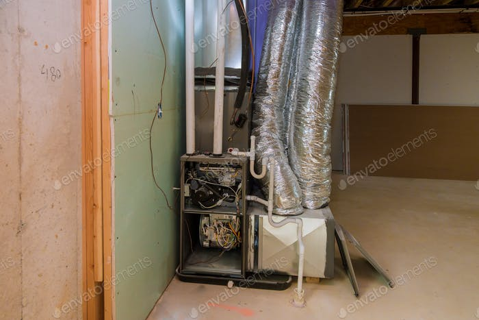 New home construction with installation of heating system in basement of house under remodeling