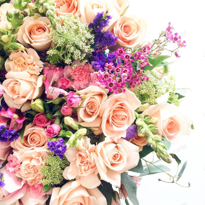 Looking down at a large bouquet of colorful flowers on a white background.