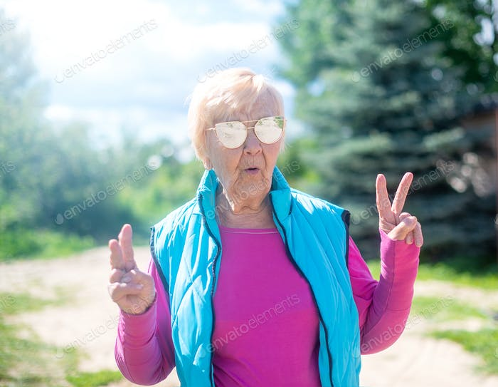 Fashionable 90 year old hipster granny outdoors in summer.