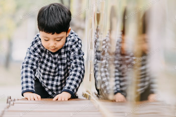 A little boy at the Playground