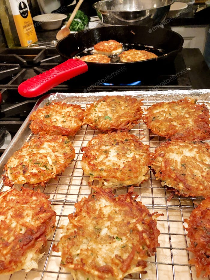 Traditional Hanukkah latkes (potato pancakes) made from scratch to celebrate the first night of the