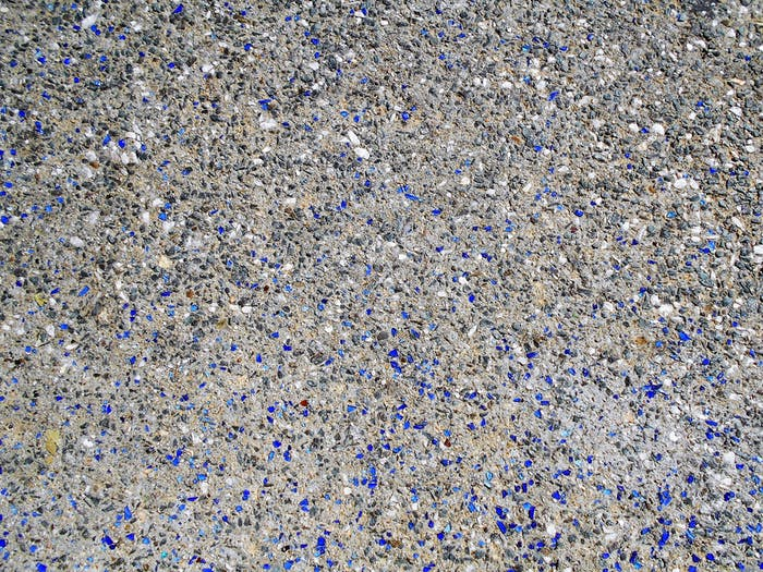 Texture! The colored gravel and stone of a walkway.