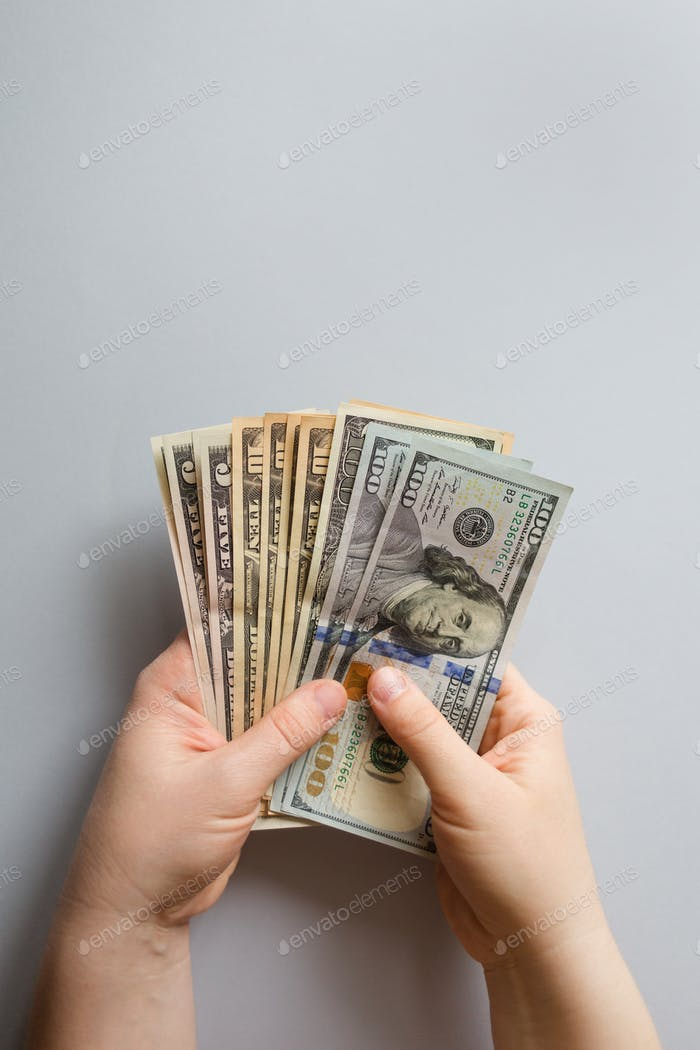 monetary background. money dollars in hand with copy space