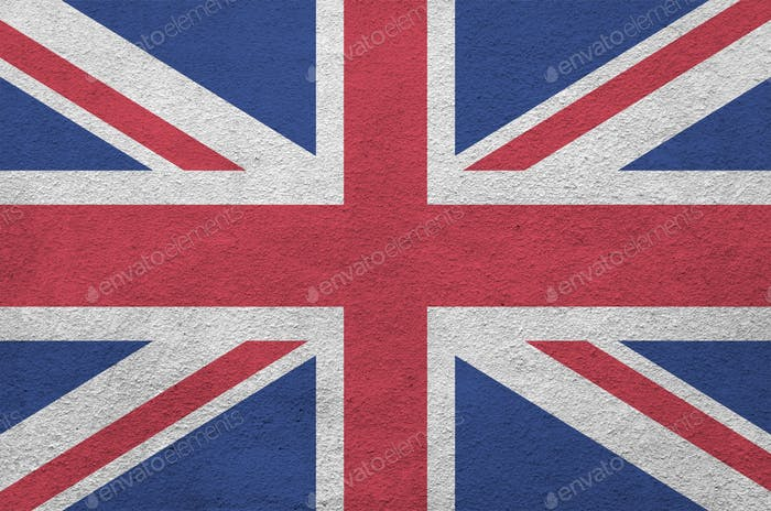 Great britain flag depicted in bright paint colors on old relief plastering wall close up
