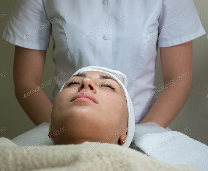 Woman's health. Young woman at skin care spa, lying down prepared for the massage