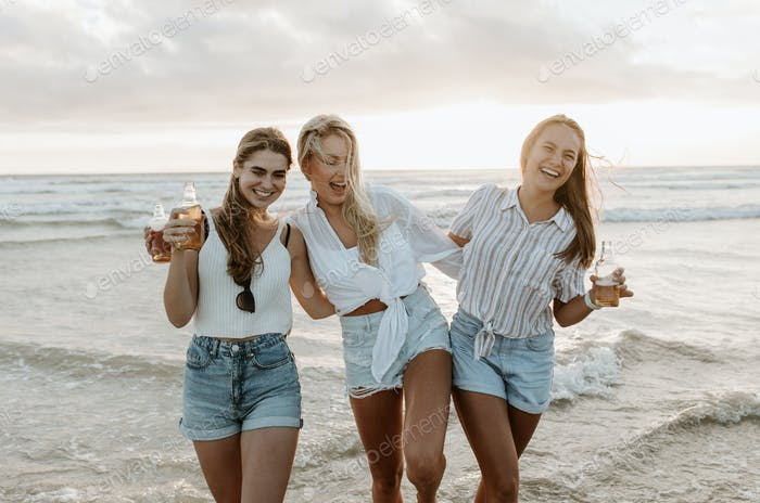 Friends being silly on the beach