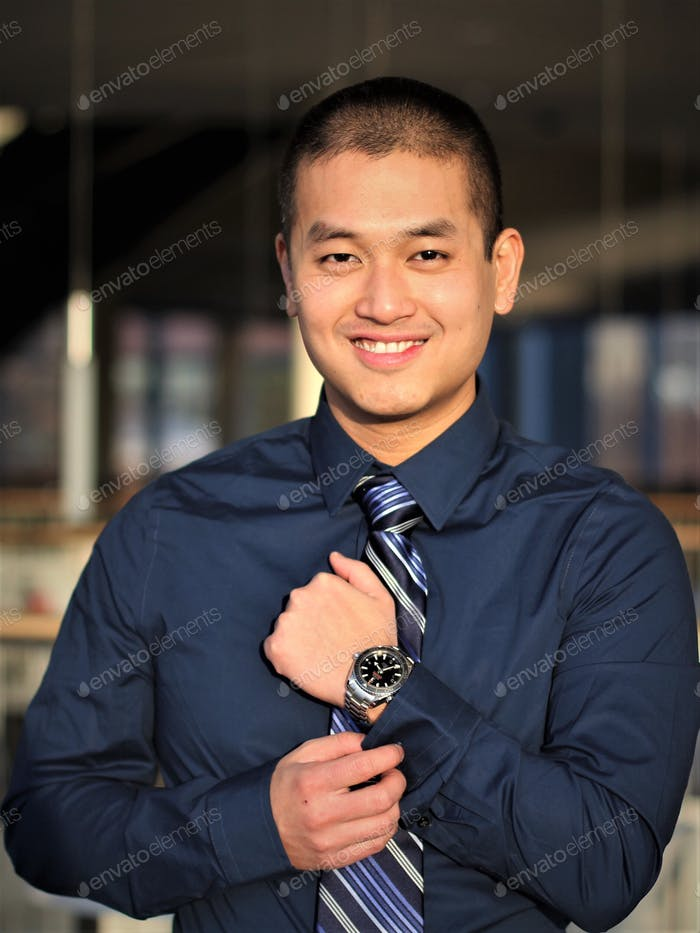 Professionally dressed millennial man with wrist watch