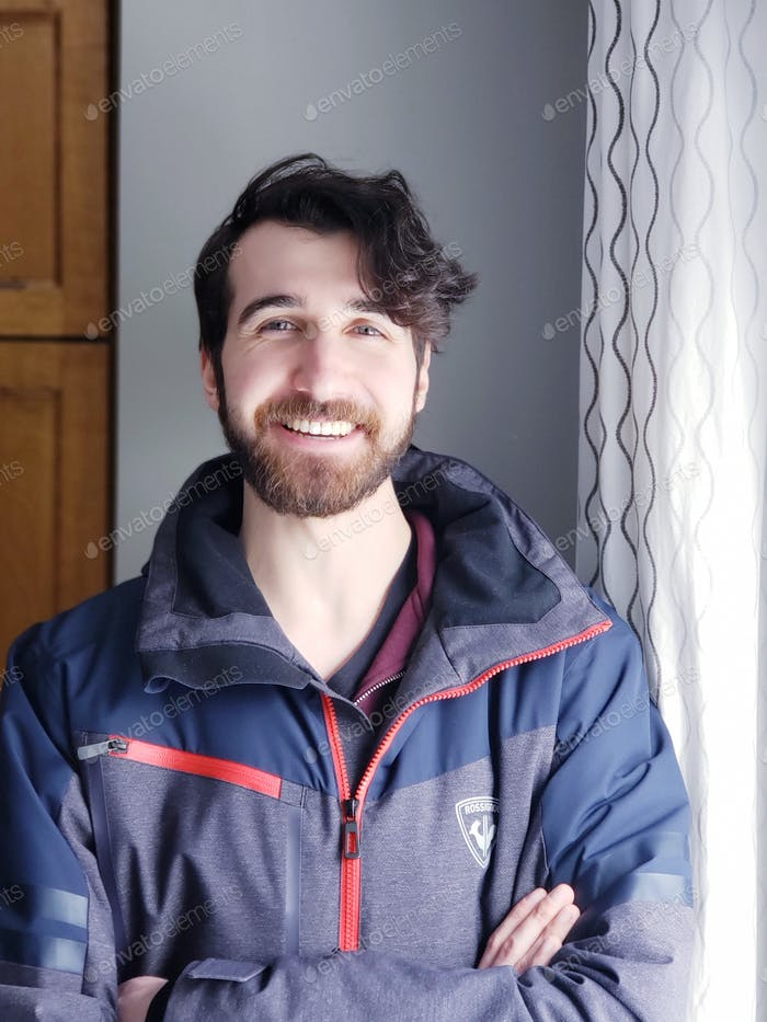 Smiling happy young man looking at camera, personality, bearded man, millennial,  portrait