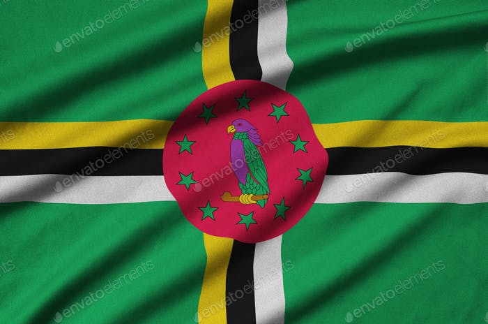 Dominica flag  is depicted on a sports cloth fabric with many folds. Sport team waving banner