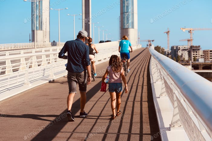 People going for a walk on the bridge in Bordeaux