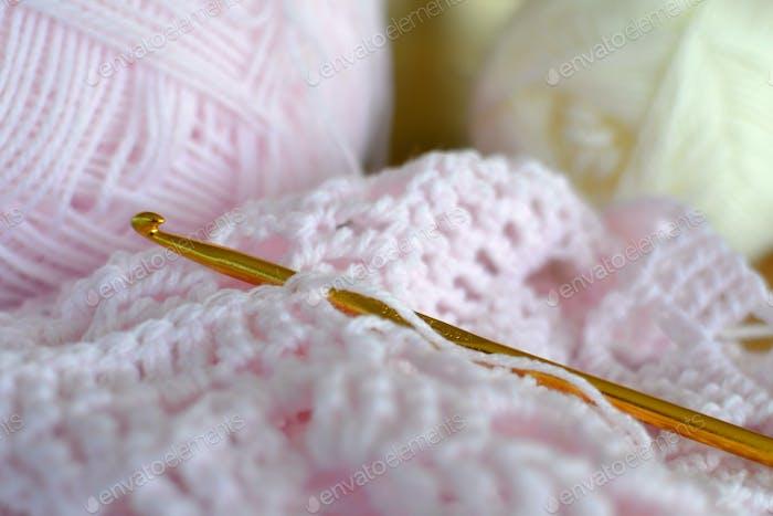 Crocheting  a baby blanket with pastel pink yarn, crochet hook, hobby, hobbies, DIY
