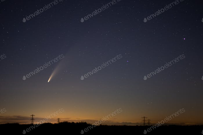 View of the C/2020 F3 (NEOWISE) comet with tail. Starry night sky