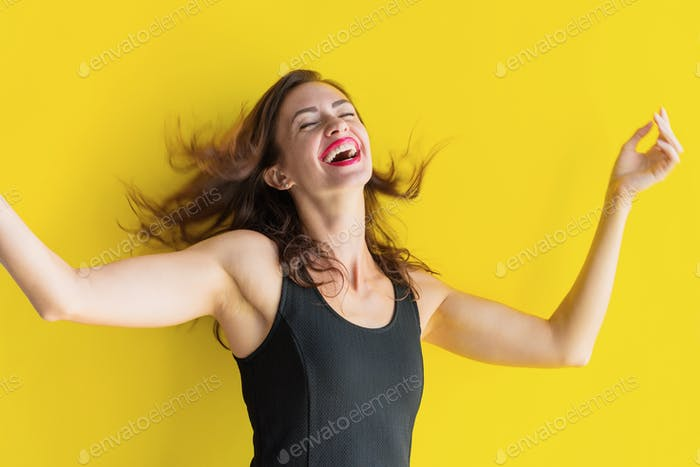 Young woman in black dress with happiness emotion Emotional portrait for study by a psychologist