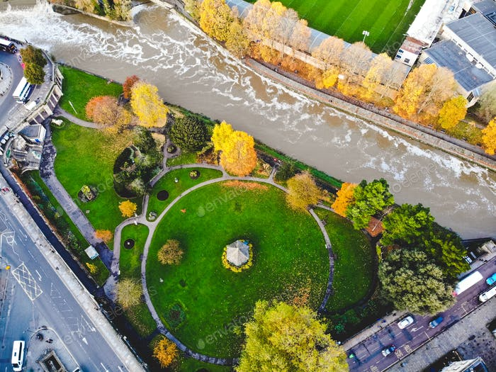 Drone photo of Bath, England river and park with gazebo in the fall/autumn