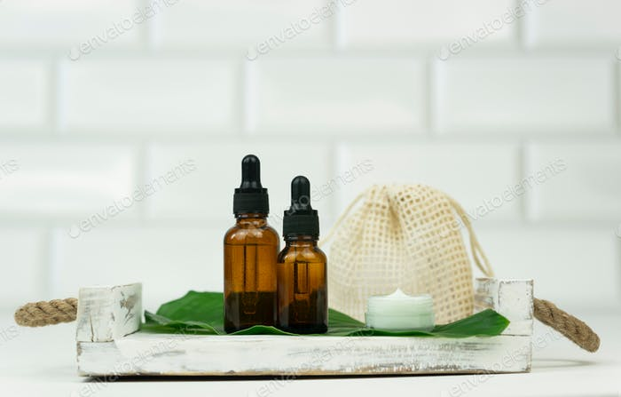 Wellness and spa concept. Body care. Natural oil. Unbranded bottle.Serum and cream