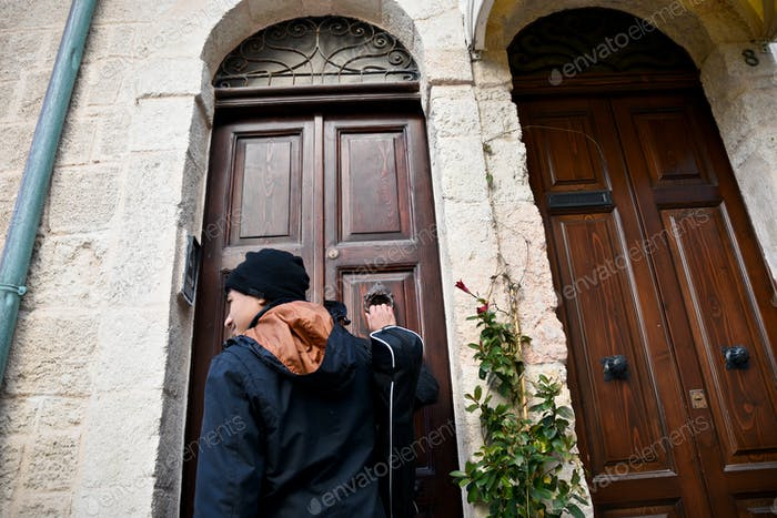 Young man knocking on a door