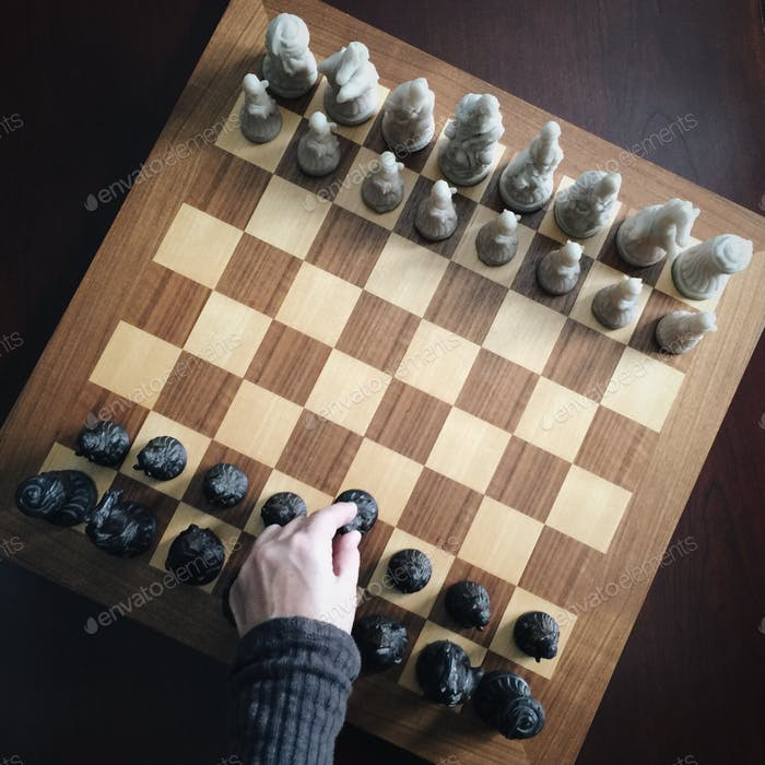 Chess Anyone? Hand in frame, playing, games, indoors, fun activities, chess, strategy, sandstone, wo