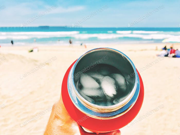 NOMINATED Ready for a sip!! Using a reusable metal, insulated drink container at the beach