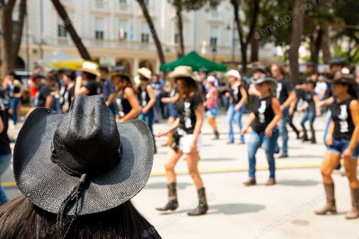 Black hat on flash mob background