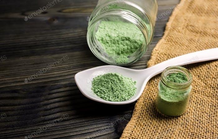 Kratom powder in jar and spoon, mitragyna speciosa