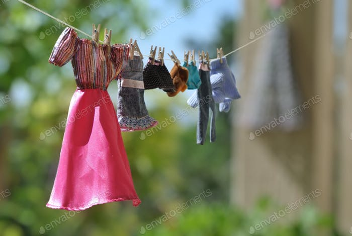 Barbie clothes hanging on a clothesline.