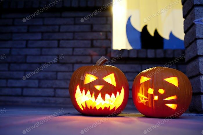 Carved pumpkins at night