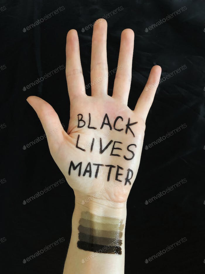 A hand in the air with Black Lives Matter words, equality, protests, protester, slogan, human hand