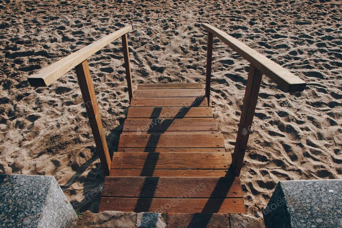 Wooden stair. Beach. Sand. Wood. Steps. Summer. Leisure. Vacation. Diminishing perspective.