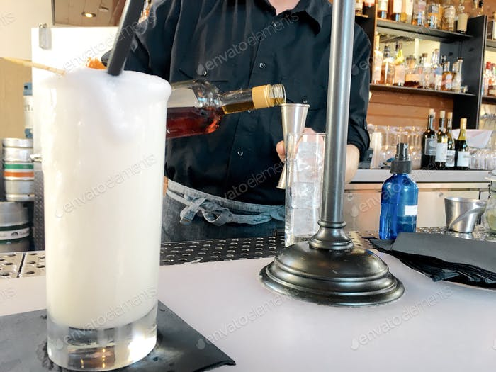 Pour me another - Bartender - mixing drinks