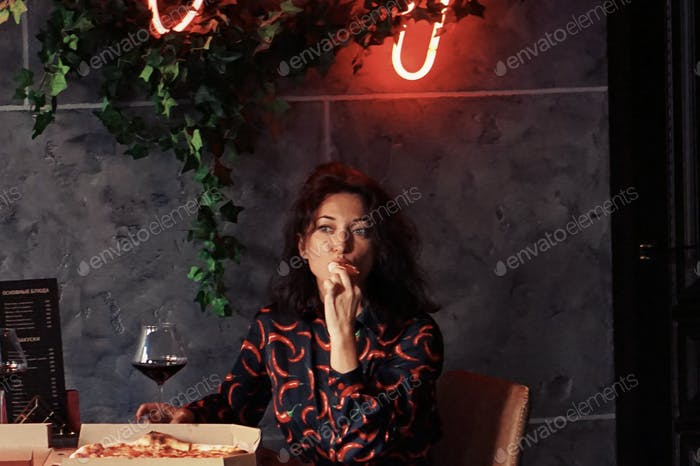 Woman eating and drinking