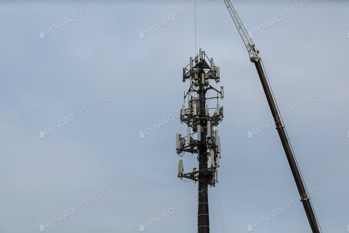 Worker Cliping Carabiner Harness for Safety on Antenna Tower installation of telecommunication tower