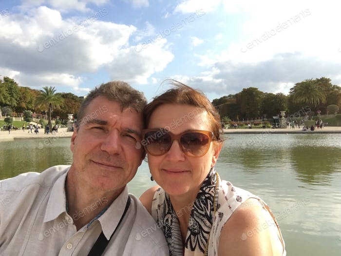 Older couple is sightseeing on the traveling adventure and taking selfy photos, happy people portrai