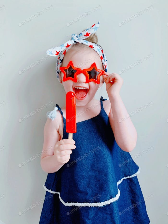 Little girl dressed for 4th of July (Independence Day USA) festivities.