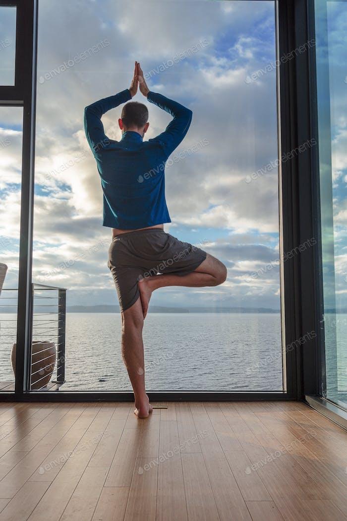 Window view yoga man