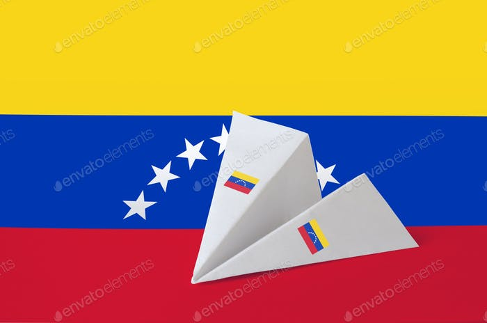 Venezuela flag depicted on paper origami airplane. Oriental handmade arts concept
