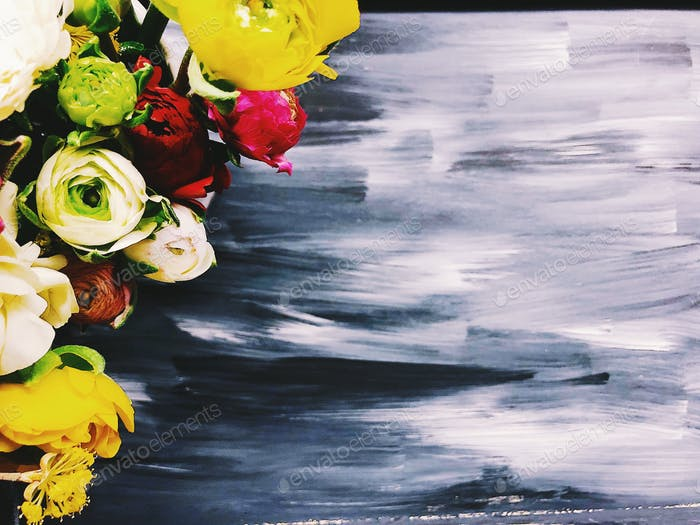 Ranunculus flowers and acrylic painted background
